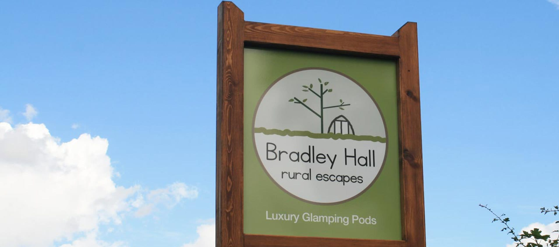 Signpost at Bradley Hall Rural Escapes - Luxurious Glamping Pods on a working farm in Cheshire